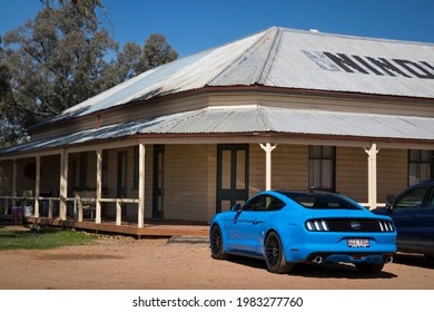 Nindigully, Queensland - October 4, 2020: Rear view of a blue 2017 Ford Mustang GT coupe parked outside the Nindigully Pub. The Nindigully Pub is Queensland's oldest pub, established in 1864.