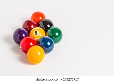 Nine Ball racked in a diamond shape on a plain white background left side.