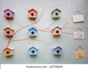 Nine cute little bird house on paint wall