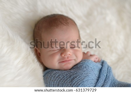 6d59c3e52 Nine day old newborn baby boy leaning against a tiny, orange and white  surfboard.