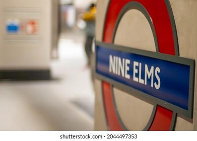 NINE ELMS, LONDON, ENGLAND- 20 September 2021: Nine Elms Station roundel logo on the platform on the first day of opening to passengers
