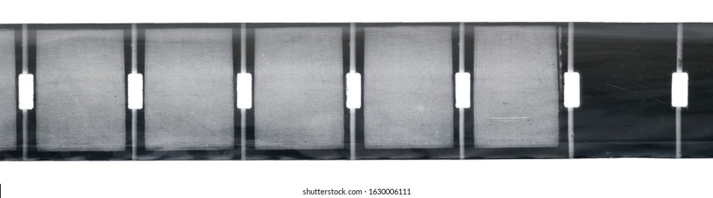 nine and a half or 9,5mm filmstrip with middle central perforation isolated on white background behind foil, safetyfilm or vintage exposed film strip, real scan of cinefilm with blank frames.