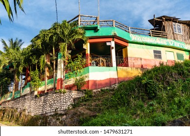 Nine Mile, Jamaica JANUARY 07, 2017: House decorated by the Bob Marley's colors: Red, Yellow, Green. Outside of Mausoleum compound at Nine Mile village