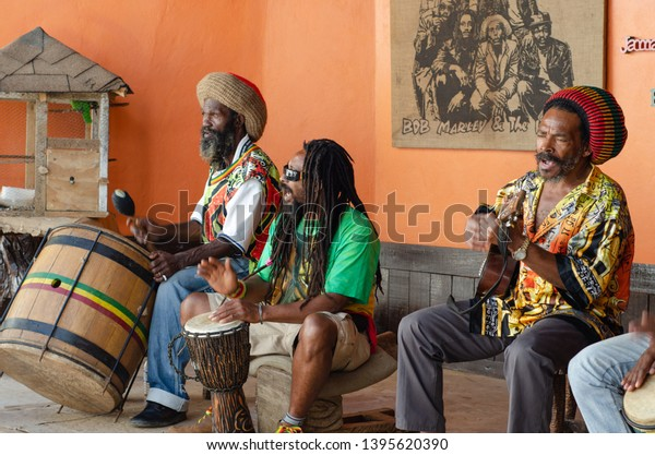 NINE MILE, SAINT ANN PARISH / JAMAICA - FEBRUARY 9, 2012 - A tribute band entertains tourists visiting the home and grave of legendary reggae musician Bob Marley at Nine Mile, Jamaica with One Love