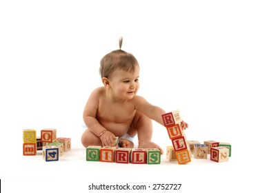 nine month old baby girl playing with blocks