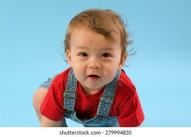 Nine month old baby male with blue background