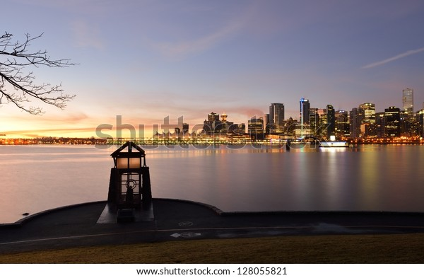 Nine O'clock Gun and Vancouver cityscape at sunrise, from Stanley Park