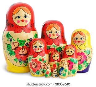 Nine traditional wooden Russian dolls arranged in group. Isolated on white background.
