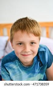 nine year old blonde boy smiling