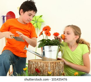 Nine Year Old Boy and Girl Working Together in Garden Over White Background