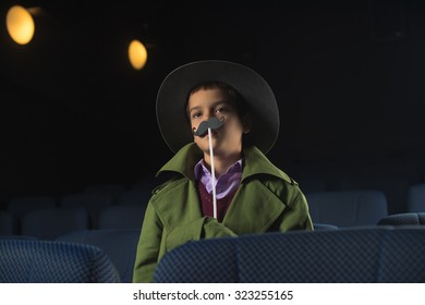 Nine years old boy came to watch adult  movie