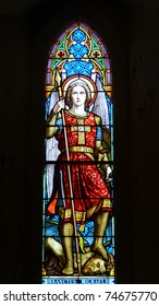Nineteenth century church window Saint Michael defeating Satan