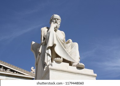 Nineteenth century neoclassical statue of ancient Greek philosopher Socrates outside the Academy of Arts of Athens in Greece.