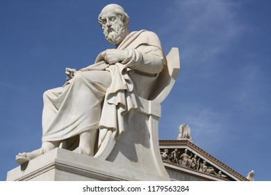 Nineteenth century neoclassical statue of ancient Greek philosopher, Plato, in front of the Academy of Arts in Athens, Greece.
