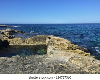 Nineteenth century rock cut bathing pool on the coast in Sliema, Malta