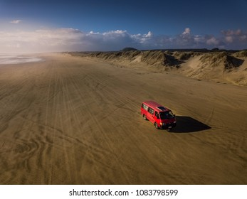 Ninety miles beach with red van, New Zealand
