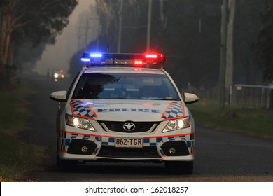 NINGI, AUSTRALIA - NOVEMBER 9 : Police holding cordon in front of bush fire front as it approaches houses November 9, 2013 in Ningi, Australia