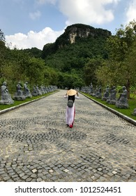 ninh binh, viet nam - 11/16/2016 Best traditional clothes in vietnam is Ao Dai and conical leaf