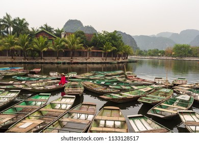 Ninh Binh, Vietnam - April 17, 2018: Woman boat riders wait for the tourists to take a boat trip on Tam Coc river