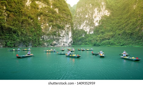 Ninh Binh, Vietnam - April 5th, 2019: The boatman is waiting for a tourist on Ngo Dong river of the Tam Coc National Park. Tam Coc is a popular tourist destination in Ninh Binh, Vietnam.