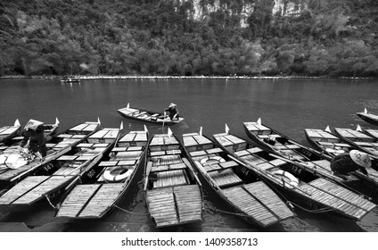 Ninh Binh, Vietnam - April 5th, 2019: Marina and the ferryman crowded picking up on Ngo Dong River Tam Coc of the National Park. Tam Coc is a popular tourist destination in Ninh Binh, Vietnam.