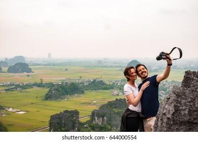 Ninh Binh, VietNam, May 19, 2017, traveler , trekking, Take a photo on Lying dragon Top on Mua cave,  landscape in NinhBinh, VietNam, Tamcoc view from Mua cave.