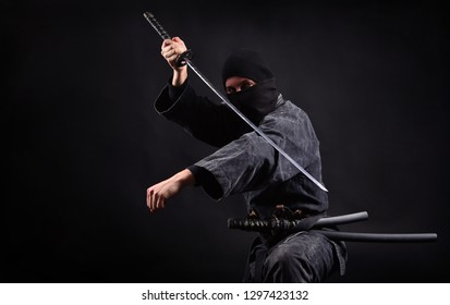 Ninja samurai with katana in attack pose