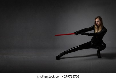 ninja with sword on hand, dark background