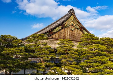 The Ninomaru Palace roof above the trees in Nijo-jo Castle in Kyoto. Japan.UNESCO World Heritage Site.