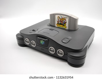 Nintendo 64 : Bangkok, Thailand - July 12, 2018 : Nintendo 64, the home video game console produced by Nintendo, isolated on white background.