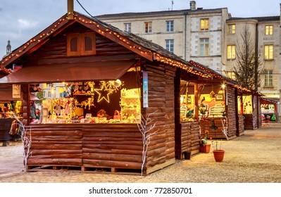 Niort, France - December 05, 2017: craftsman's cottages with illuminations of Christmas around on the main square of downtown niort