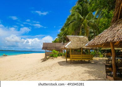 Nipa huts on a tropical island beach
