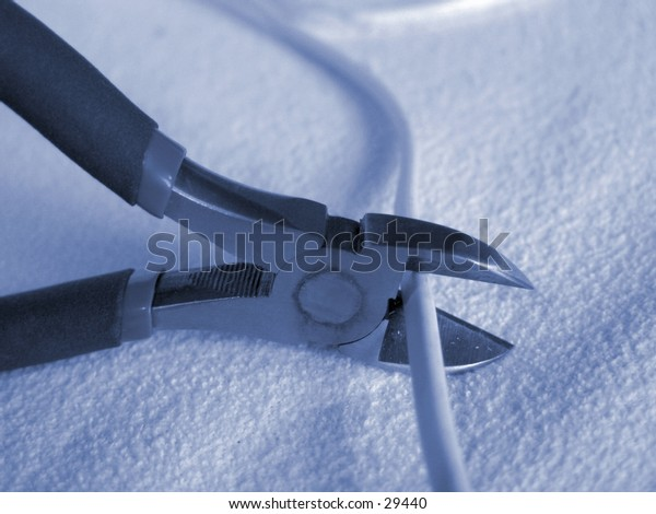 Nippers cutting a wire