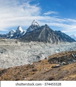 Nirekha (6169 m), Kangchung (6063 m), and Cholo (6089 m) in the area of Cho Oyu. View Ngozumba glacier near Thopak Tsho (4990 m) - Gokyo region, Nepal, Himalayas