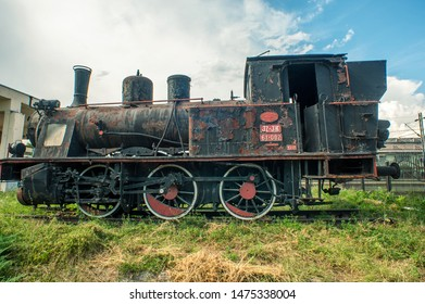 Nis, Nis / Serbia - 08 01 2019: An old rusty locomotive in front of the main train station of the city.