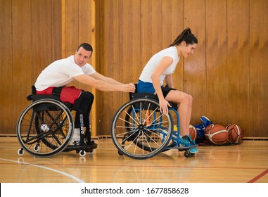Nis, Serbia - February 28, 2020: Physically handicapped people play Wheelchair basketball as part of a presentation for interested students of the Faculty of Sports.
