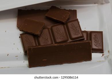 NIS, SERBIA -JANUARY 10, 2017: : close-up chocolate bar Milka old wooden background, alpine milk chocolate. Illustrative editorial - Image