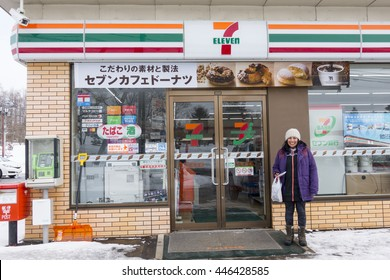 NISEKO, HOKKAIDO/JAPAN - FEB 23, 2016: Foreigner Standing Outside a Seven and I Holdings 7-11 Convenience Store in Niseko