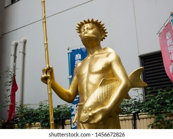 NISHI-ASAKUSA, TOKYO / JAPAN – JULY 10, 2019: The view of statue of a kappa on Kappabashi-dori street which is almost entirely populated with specializing shops for kitchen wares.