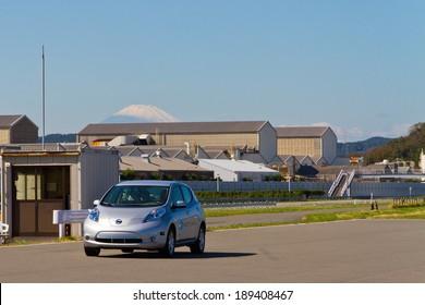 Nissan Leaf with Mount Fuji Tokyo, Japan OCT 19 2013 : Nissan Leaf with Mount Fuji in   Nissan GRANDRIVE on OCT 19 2013.