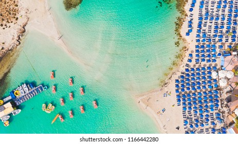 Nissi beach in Ayia Napa, clean aerial photo of famous tourist beach in Cyprus, the place is a known destination on island and is formed from a smaller island just near the main shore