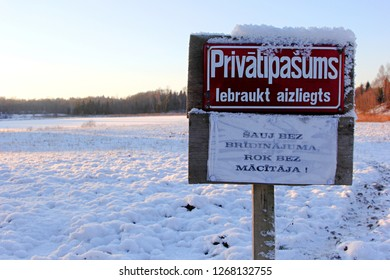 Nitaure, Latvia january 22, 2014: Cold and sunny winter day with red sign: Private Property