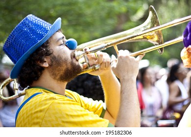 NITEROI, BRAZIL - MAY 6, 2012: People in costumes playing instruments while taking part in a Carnival-like parade, celebrating the anniversary of a local street band. May 6, 2012 in Niteroi, Brazil