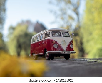 NITRA, SLOVAKIA - APRIL 21 2019: Volkswagen Transporter T1 in summer nature. Scale model Volkswagen Transporter 1:43. Classic caravan in summer park. VW Bulli on summer ride.