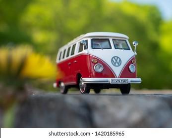 NITRA, SLOVAKIA - APRIL 21 2019: Volkswagen Transporter T1 in summer nature. Scale model Volkswagen Transporter 1:43. Classic caravan in summer park. VW Bulli on summer ride.