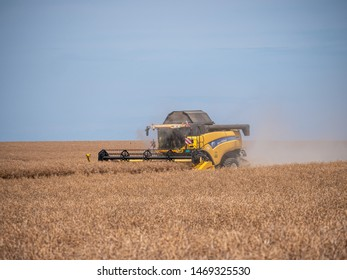 NITRA, SLOVAKIA - JULY 27 2019: New Holland CX8080 on a field in sunny summer day. Combine harvest on field. Summer harvest and blue sky. Harvesting on field.