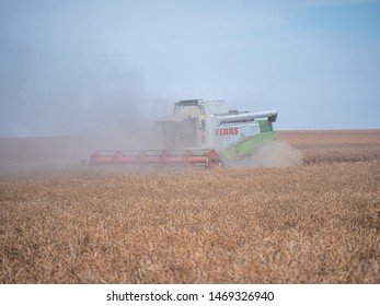 NITRA, SLOVAKIA - JULY 27 2019: CLAAS combine harvesters LEXION 460. Combine harvest on field. Summer harvest and blue sky. Harvesting on field. Harvests wheat in the fields in summer.