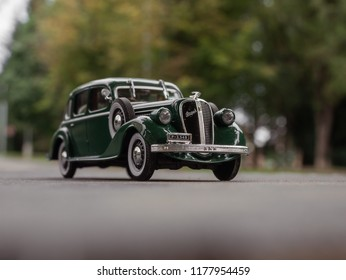 NITRA, SLOVAKIA - JUNE 14 2018: Scale model SKODA Superb 1934 on the road. Classic car SKODA Superb closeup photo. Retro car on the way. Skoda Superb in the city.