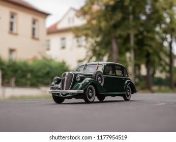 NITRA, SLOVAKIA - JUNE 14 2018: Scale model SKODA Superb 1934 on the road. Classic car SKODA Superb closeup photo. Retro car on the way. Skoda Superb in the city.