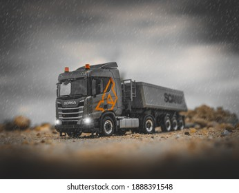 NITRA, SLOVAKIA - JUNY 03 2018: Gray Scania CR XT with dumper tralier. Gray truck with trailer. Scania truck on the road. Scale model from Herpa model, 1:87.
